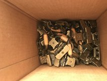 Box of cabinet door hinges and handles in Plainfield, Illinois