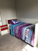 Twin size bedframe with storage and mattress included in Tacoma, Washington