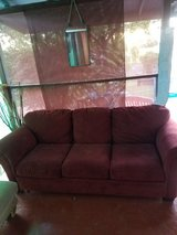 Red couch in Alamogordo, New Mexico