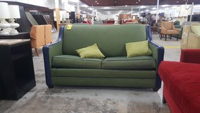 Green and blue couch in Camp Lejeune, North Carolina