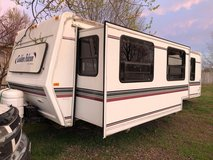 31' Golden falcon travel trailer with slide for sale or trade for motorhome in Lake of the Ozarks, Missouri