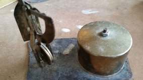Old brass stamp and weigh holder in Houston, Texas