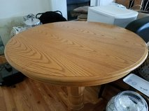 Solid oak pedestal table with 4 matching stools in Naperville, Illinois