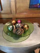 Large green glass bowl with decorative balls in The Woodlands, Texas