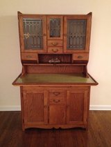 Antique oak hutch with etched glass in doors in Chicago, Illinois