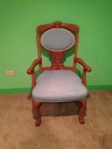 Antique claw-foot chair with upholstering in Chicago, Illinois