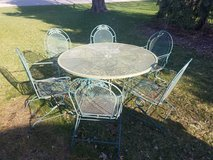 Round wrought iron patio table and 6 chairs in Chicago, Illinois