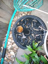 Cast iron umbrella holder in Vacaville, California