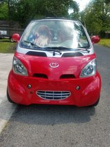 Red Electric Car in Spring, Texas