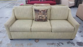 Light green couch in Camp Lejeune, North Carolina