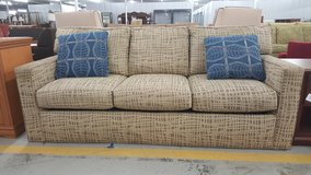 Tan patterned couch in Camp Lejeune, North Carolina