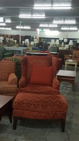 Red chair w ottoman in Camp Lejeune, North Carolina