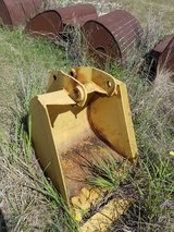 Mini Excavator Digging Bucket in Conroe, Texas