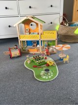 Hape Wooden Doll House with Car! in Ramstein, Germany