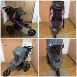Pink BOB jogging stroller with new rain cover in excellent condition. in Stuttgart, GE