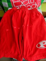 Red Sports Shorts size adult small in Byron, Georgia