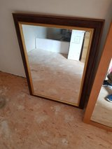 Elegant faux mahogany and gold mirror in Ramstein, Germany