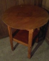 very old wooden round table in Alamogordo, New Mexico