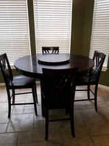 Solid wood five piece dining room set with lazy susan sold as is in Spring, Texas
