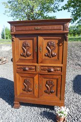beautiful cabinet with ornate fish carvings in Stuttgart, GE
