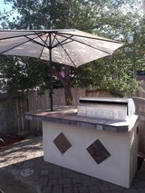 7 ft 5 burner outdoor kitchen with gas grill and mini fridge in Spring, Texas