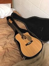 acoustic guitar with hard case and capo in Camp Lejeune, North Carolina