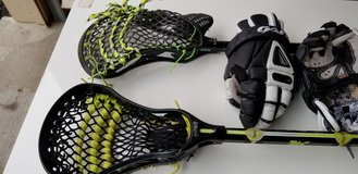 Lacrosse sticks and gloves. reebok and gant. in Quantico, Virginia