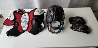 Lacrosse helmet and shoulder pads and elbow pads in Quantico, Virginia