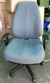 Large Gray Armed Office Desk Chair on Wheels in Fort Lewis, Washington