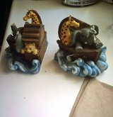 Bookends. Giraffe ear broke and elephant trunk glued on in Los Angeles, California