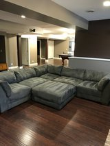 Sectional couch with ottoman in Elgin, Illinois