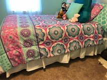 twin bed and comforter in Conroe, Texas