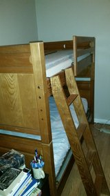 solid wood twin bunk beds with matching corner desk. in Cherry Point, North Carolina