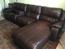 Leather couch w/ two reclining sections, cup holder/storage bin, and lounge end in Warner Robins, Georgia