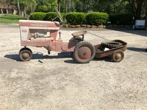 Antique pedal tractor which trailer in Kingwood, Texas