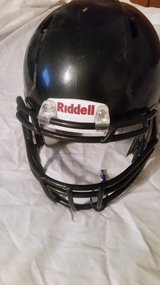 Boys Youth Riddle Football Helmet and pants and baseball wrist protector. in Leesville, Louisiana