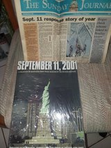 911 book and front section of newspaper in Kankakee, Illinois
