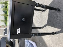 Black beddroom end table in Yorkville, Illinois