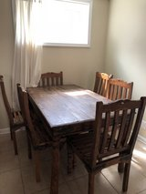 Hutch and table set with six chairs in Pensacola, Florida
