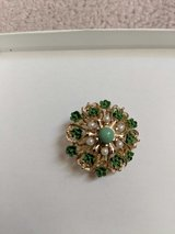 Beautiful green and gold vintage pin in Eglin AFB, Florida