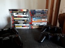 PS3 and 24 PS3 game lot with 4 controllers and Bluetooth headset in Grafenwoehr, GE