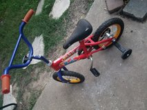 Bike with training wheels in Kingwood, Texas