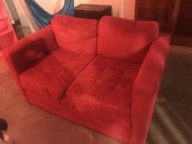 red love seat in Fort Campbell, Kentucky