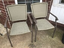 Two bronze/brown and tan plastic wicker outdoor chairs in Perry, Georgia