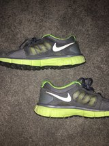 green and grey Nike gym shoes in Naperville, Illinois