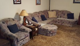 Complete German living room couch sectional with roll away bed inside and a matching easy chair. in Fort Leonard Wood, Missouri