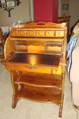 Older Solid Wood secretarial roll top desk in Naperville, Illinois