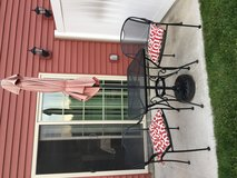 Rod iron table and chair set in Fort Drum, New York