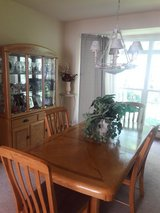 Oak dining table, 4 chairs, and China cabinet in Naperville, Illinois