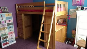Oak loft bed with dresser, desk, and shelving. in Aurora, Illinois